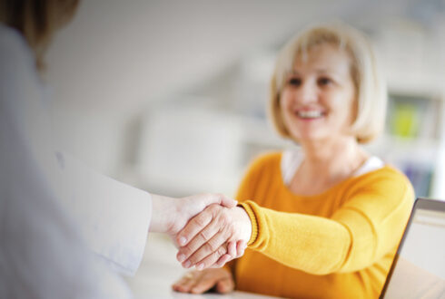 Woman shaking hand with doctor