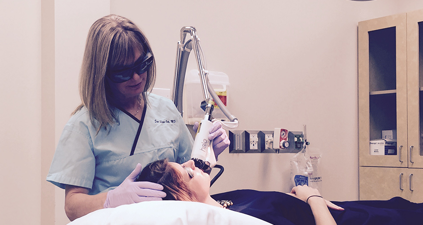 Dr. Cox performing a Laser treatment on patient